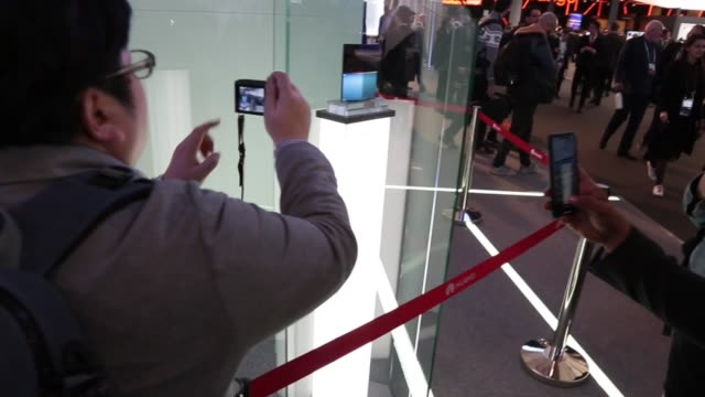 visitors attending the huawei mate x 5g device are seen during the mobile world congress 2019 in barcelona spain on february 25 2019 the presence of... - attending stock videos and b-roll footage