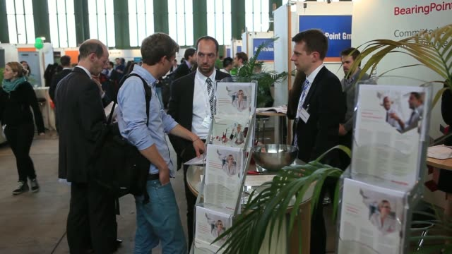 stockvideo's en b-roll-footage met visitors browse company stands and speak to recruiters during the connecticum job fair for students graduates and young professionals at tempelhof... - banenbeurs