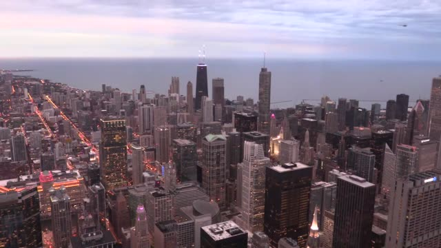 visitors check out the view from the skydeck ledge, which is located on the 103rd floor of willis tower, second-tallest in united states, in chicago,... - willis tower stock videos & royalty-free footage