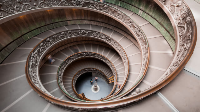 t/l visitors descending the spiral stairs of the vatican museums / vatican city, vatican - italian culture stock-videos und b-roll-filmmaterial
