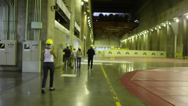 visitors during a guided tour the itaipu binacional dam is s a hydroelectric dam and hydroelectric power station on the paraná river located on the... - hydroelectric power stock videos & royalty-free footage