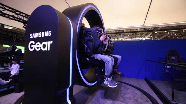 visitors enjoy a samsung gear vr 4d virtual reality experience during the mobile world congress 2017 on the opening day of the event at the fira gran... - exhibition stock videos and b-roll footage
