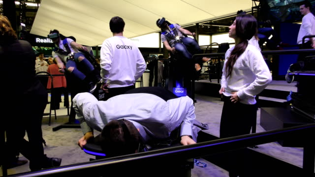 visitors enjoy a samsung vr virtual reality experience during the mobile world congress 2017 on the opening day of the event at the fira gran via... - exhibition stock videos and b-roll footage