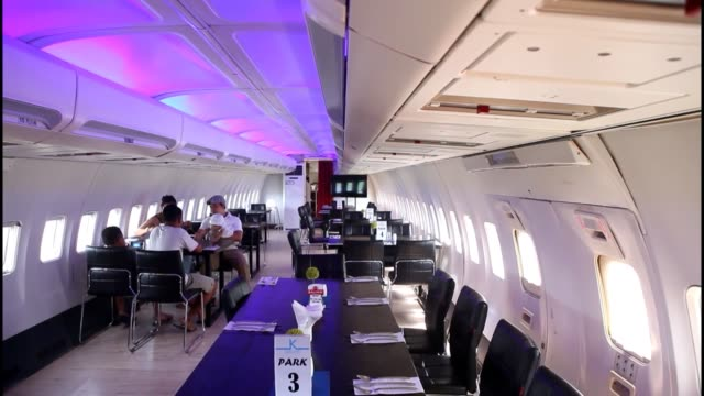 Visitors enjoy their meals inside of Boeing 747400 converted into restaurant at Keramas Aero Park in Gianyar Bali Indonesia on April 03 2017 The row...
