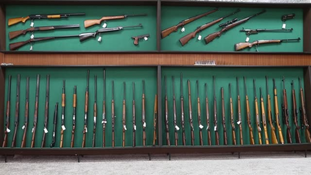 visitors exit the zastava oruzje ad firearms factory in kragujevac serbia on tuesday oct 14 tilt down various machine guns and rifles displayed on a... - förvaringsställ bildbanksvideor och videomaterial från bakom kulisserna