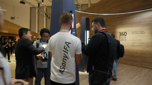 visitors have a look at the new 360 audio reality music experiences at sony hall at the 2019 ifa home electronics and appliances trade fair on... - audio electronics stock videos & royalty-free footage