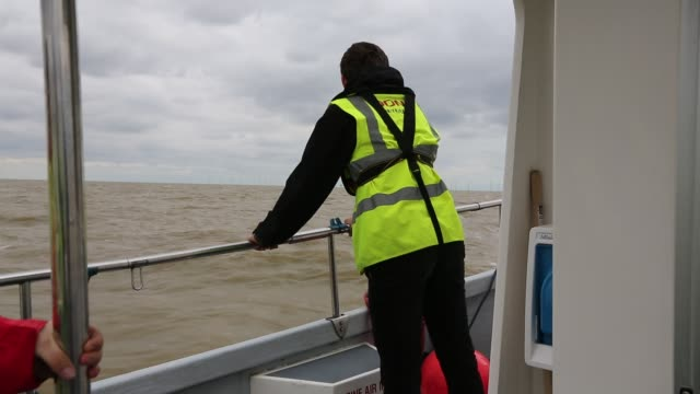 visitors heading to gunfleet sands offshore wind farm is owned and operated by dong energy. it consists of 48 turbines off brightlingsea in essex,... - minority groups stock videos & royalty-free footage