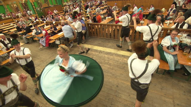visitors in  the beer tent, bavarian dance group - baviera video stock e b–roll
