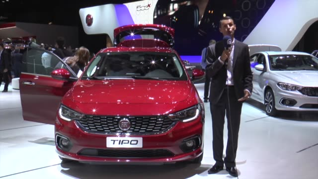 Visitors inspect new automobiles electric cars and electric hybrid automobiles during the first press day of the Paris Motor Show at Porte de...