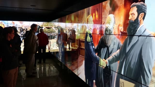 Visitors interacting with multi touch screens exhibition which introduce different nonJewish characters that have supported the Jews and Zionism and...