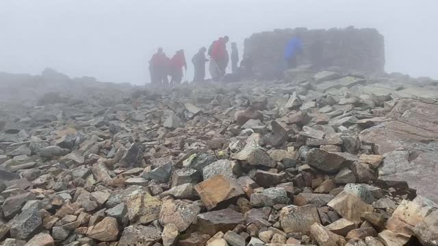 visitors leaving huge amounts of litter at british beauty spots; uk, cumbria, lake district national park; people picking up rubbish on scaffel pike,... - mountain range stock videos & royalty-free footage