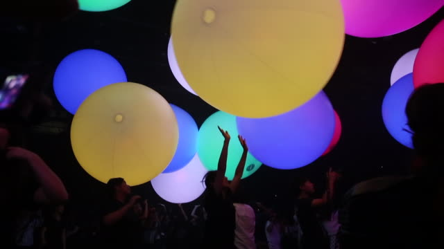 visitors look at a digital installation produced by teamlab an art collective during the teamlab jungle light art and music festival learn and play... - performing arts event stock videos & royalty-free footage