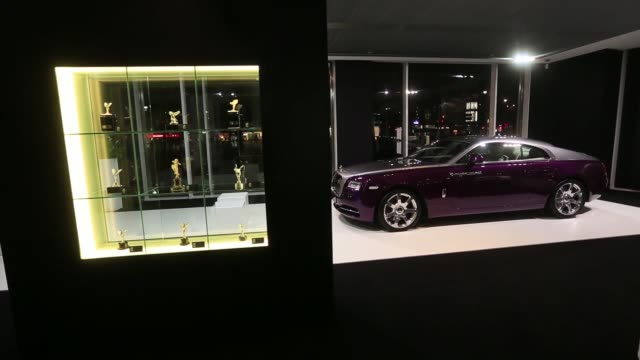 visitors look at a rolls royce wraith automobile on display at rolls royce motor cars ltds studio in berlin germany on friday jan 30 gvs of the... - nordeuropäischer abstammung stock-videos und b-roll-filmmaterial