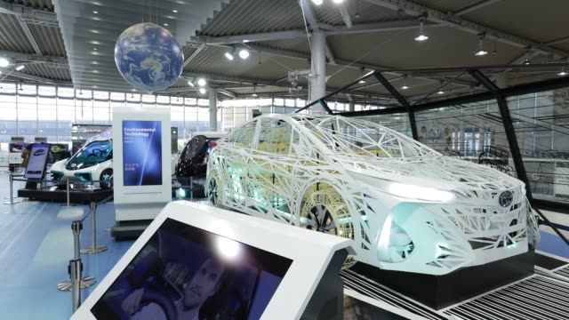 visitors look at a toyota motor corp. mirai fuel-cell vehicle as well as others on display at the company's showroom of the megaweb car theme park in... - wire frame model stock-videos und b-roll-filmmaterial