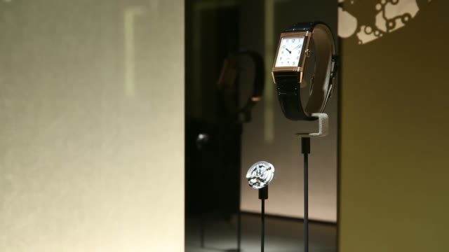 Visitors look at displays by Audemars Piguet at the Salon International de la Haute Horlogerie watch fair in Geneva Switzerland on Monday Jan 20 2014...