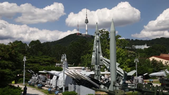 Visitors look at mock missiles on display at the War Memorial of Korea museum in Seoul South Korea on Friday Aug 11 A mock MIM 14 Nike Hercules...