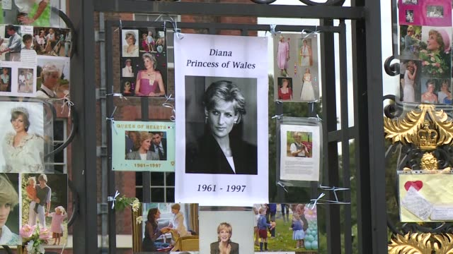 visitors look at photographs of diana princess of wales and floral tributes left outside kensington palace london ahead of the 20th anniversary of... - 20th anniversary stock videos & royalty-free footage