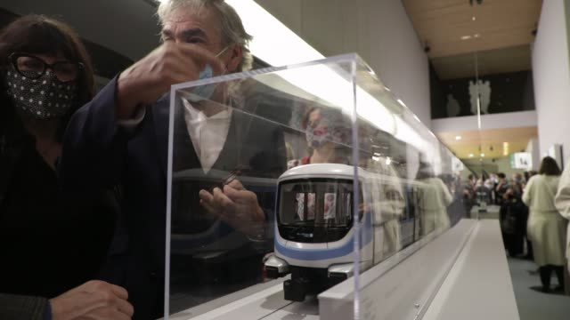 visitors look at the model of a metro during the unveil of the metro train for future lines 15, 16 and 17 of the grand paris express on october 2,... - railing stock videos & royalty-free footage