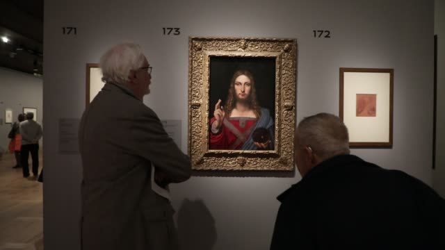 visitors look at the painting salvator mundi during the exhibition of leonardo da vinci at the louvre museum on january 16 2020 in paris france - kunst, kultur und unterhaltung stock-videos und b-roll-filmmaterial