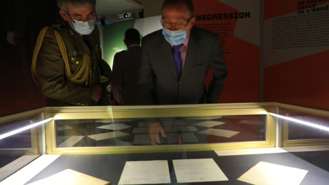 """visitors look at unpublished documents during the inauguration of the exhibition """"obey, disobey, command. de gaulle. a military career 1910-1952 """"at... - french culture stock videos & royalty-free footage"""