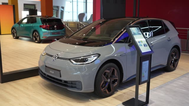 visitors look at volkswagen id.3 electric cars at the autostadt promotional facility next to the volkswagen factory on october 26, 2020 in wolfsburg,... - electricity stock videos & royalty-free footage