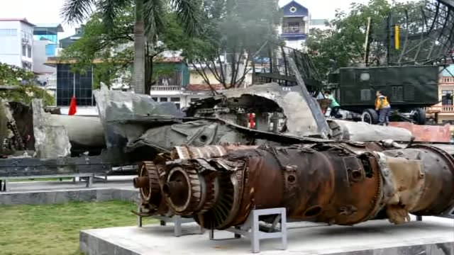 visitors look at wreckage of a downed us air force aircraft on display at the peoples armys museum in hanoi as vietnam marks the 40th anniversary of... - north vietnam stock videos & royalty-free footage