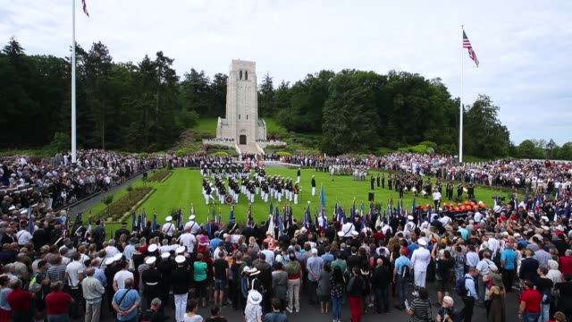 Visitors look on as US Marines and French and German soldiers commemorate the 100th anniversary of the World War I Battle of Belleau Wood on Memorial...