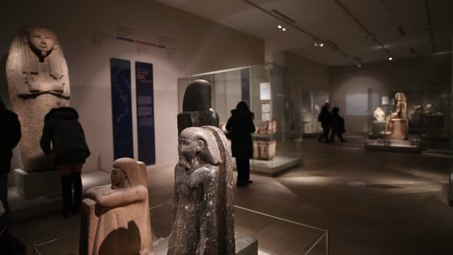 visitors looks at archaeological works inside the egyptian museum of turin on february 01, 2021 in turin, italy. the egyptian museum of turin is the... - museum video stock e b–roll