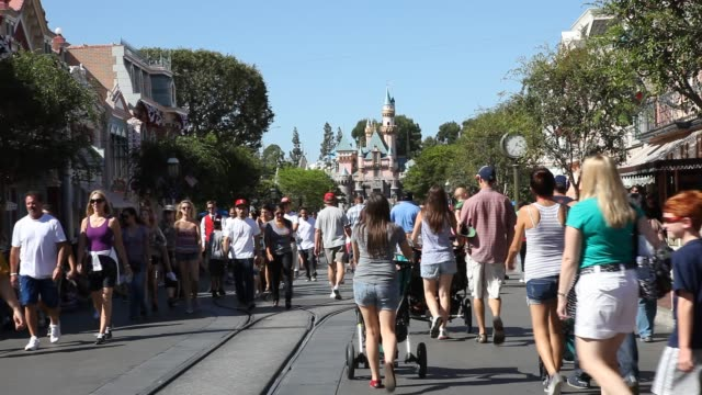 """september 02: visitors on"""" main street, u.s.a."""", in the background """"sleeping beauty castle"""" can be seen in the entertainment resort disneyland in... - anaheim california stock videos & royalty-free footage"""