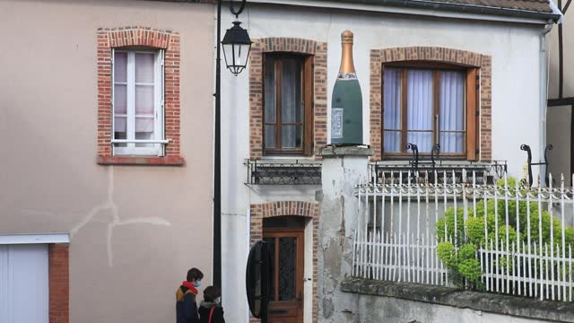 visitors pass by a bottle of champagne that decorates the entrance of a cellaron may 15, 2021 in hautvillers, france. located about 150 kilometers... - local landmark stock videos & royalty-free footage