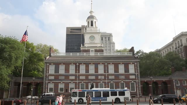 visitors pass by independence hall in philadelphia pa on saturday may 9 2015 shots exterior wide shots of independence hall close up shots of the... - independence hall stock videos & royalty-free footage