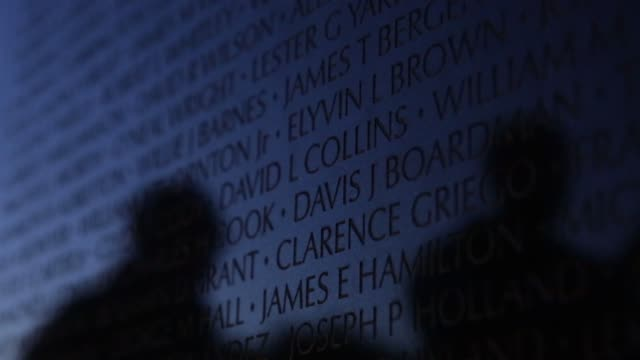 visitors pass by the wall of the vietnam veterans memorial prior to the memorial day weekend. may 23, 2014. washington, dc. - vietnam veterans memorial video stock e b–roll