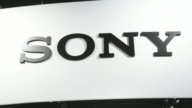 vídeos de stock e filmes b-roll de visitors pass the sony corp pavilion on day three of the mobile world congress in barcelona spain on wednesday feb 26 sony signage various shots... - sony