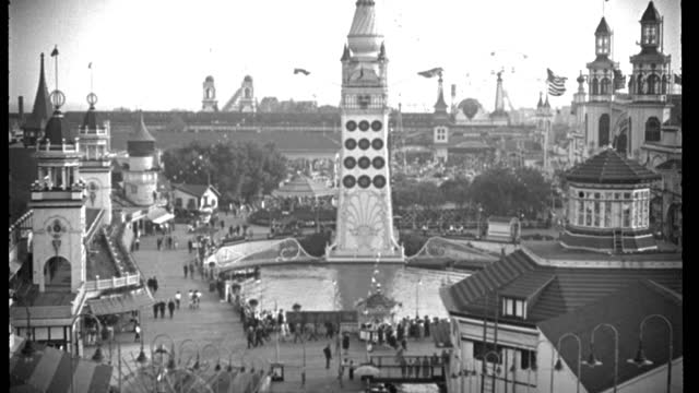 visitors pass under dreamland tower and lagoon at coney island, brooklyn, new york, in 1934. - 1934 stock videos & royalty-free footage