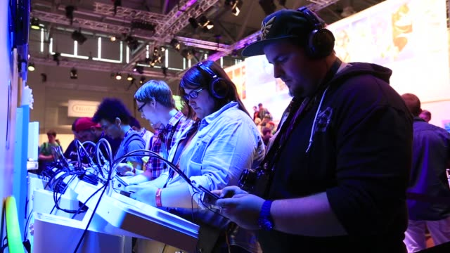 visitors play games on nintendo co 3ds handheld gaming consoles at the gamescom video games trade fair in cologne germany wideshots of various game... - handheld video game stock videos & royalty-free footage