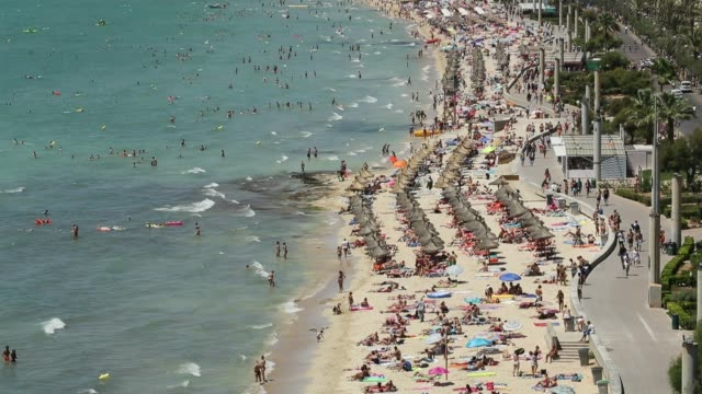 visitors relax at the beach along the ballermann stretch on july 27 2017 in palma de mallorca spain the term ballermann which combines the spanish... - majorca stock videos & royalty-free footage