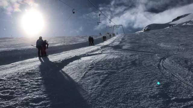 visitors ride a ski lift up a glacier on kitzsteinhorn mountain at the kaprun ski resort in the austrian alps on february 9, 2018 near kaprun,... - österrikisk kultur bildbanksvideor och videomaterial från bakom kulisserna