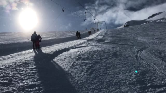 Visitors ride a ski lift up a glacier on Kitzsteinhorn mountain at the Kaprun ski resort in the Austrian Alps on February 9 2018 near Kaprun Austria...