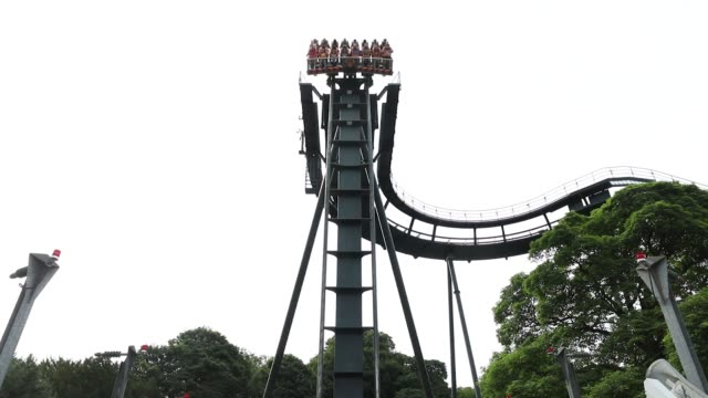 Visitors ride the Congo River Rapids ride at the Alton Towers theme park owned and operated by Merlin Entertainments Plc in Alton UK on Tuesday July...