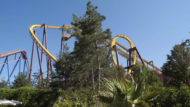visitors ride the 'superman attraction of steel' roller coaster and batman: arkham asylum roller coaster at parque warner madrid on july 30, 2021 in... - superman superhero stock videos & royalty-free footage