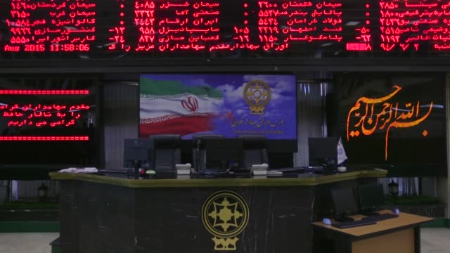 visitors sit in a viewing area and look at financial information displayed on digital screens at the tehran stock exchange in tehran iran on monday... - authority stock videos & royalty-free footage