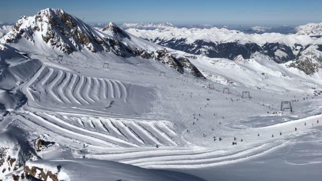 Visitors ski down a slopeon a glacier on Kitzsteinhorn mountain at the Kaprun ski resort in the Austrian Alps on February 9 2018 near Kaprun Austria...
