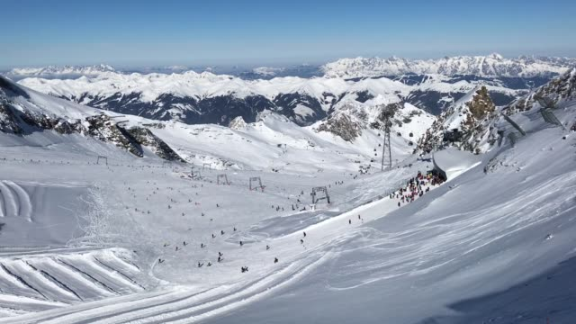 visitors ski down a slopeon a glacier on kitzsteinhorn mountain at the kaprun ski resort in the austrian alps on february 9, 2018 near kaprun,... - traditionally austrian stock videos & royalty-free footage