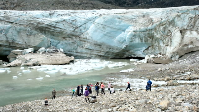 visitors stand at a wall of ice of the pasterze glacier on august 13, 2019 near heiligenblut am grossglockner, austria. the pasterze, austria's... - human tongue stock videos & royalty-free footage