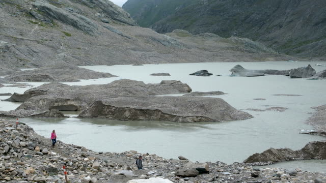 visitors stand at the shore of pasterze glacier on august 13, 2019 near heiligenblut am grossglockner, austria. the pasterze, austria's largest... - human tongue stock videos & royalty-free footage