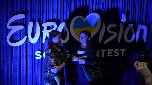 visitors stand in front a logo during the ukrainian final of the ukrainian national qualification for the eurovision song contest in kiev ukraine 25... - 61st eurovision song contest stock videos and b-roll footage