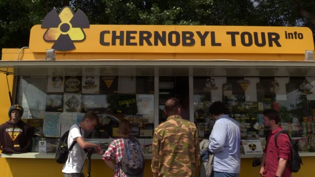 stockvideo's en b-roll-footage met visitors stand in front a tourist information's point at the dityatki checkpoint at the entrance to the chernobyl exclusion zone, ukraine, on 7 june... - kernramp van tsjernobyl