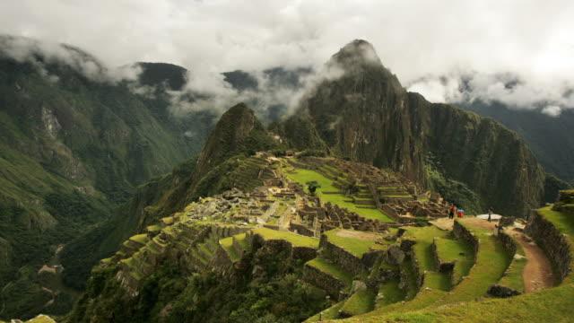 Visitors stream through a misty Machu Picchu in Peru.