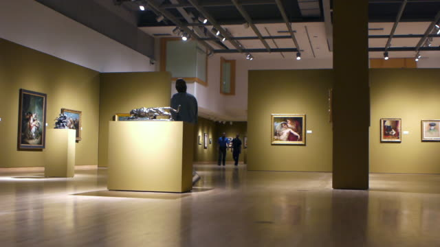 WS Visitors strolling in gallery of European paintings and sculptures from  18th and 19th centuries exhibited in art museum / Phoenix, Arizona, USA