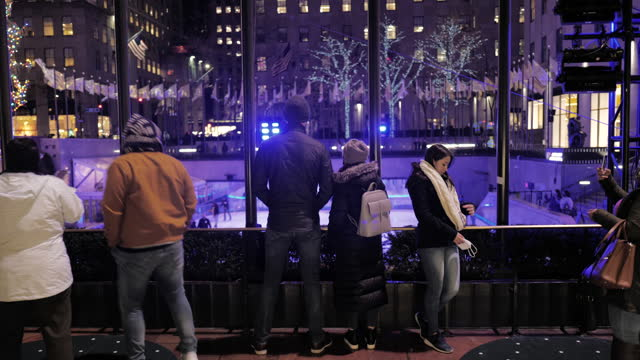 visitors take selfies and view the christmas tree at designated and socially distanced spots at the rockefeller center in midtown manhattan on... - rockefeller center christmas tree stock videos & royalty-free footage